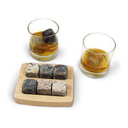 None - 'On The Rocks' Granite Chiller Stones Drinking Set - Crafted with care from stones collected from New England beaches,'On the Rocks' is a set of six granite drink chillers that perfectly chill spirits without diluting them. This set includes six chiller stones,a wooden holder and two tumblers.