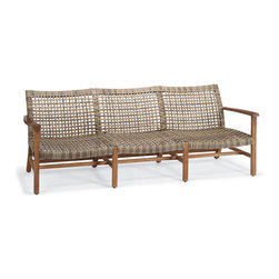 "Frontgate - Isola Outdoor Sofa, Patio Furniture - Handwoven premium resin wicker. Sustainably harvested teak is kiln dried to eliminate expansion and shrinkage. Teak will adopt a silvery patina over time. All-weather wicker has a driftwood-hued finish. Complements our Cassara Collection. With a breathable open weave, our Isola Seating Collection is the perfect fit for arid and coastal climates alike. Generously proportioned seating features solid premium teak frames wrapped in 3/4""-wide bands of driftwood-hued, all-weather wicker, widely woven for visual and tangible lightness. Curved and rounded seats and backs comfortably cradle you and each of your guests. The seating pairs perfectly with our Cassara teak accent tables.Part of the Isola Collection.  .  .  .  . . Tables require assembly"