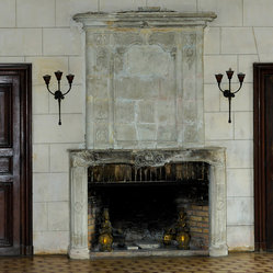 Fireplaces Hand Carved in Stone (Traditional Style) - This is a simple hand carved picture frame Bolection stone fireplace mantle installed with antique herringbone terracotta brick size tiles, Brought to you by our carvers at Ancient Surfaces.