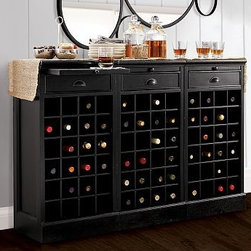 Modular Bar Buffet with 3 Wine Bases - Wine Collectors Rejoice. This cabinet (3 are shown here) can store your bottles and leave a sideboard surface on top for displays, your foot spread, or for mixing cocktails. Additionally, the drawers offer the perfect spot for stashing coasters and bottle openers, and pull out slats offer additional surface space when you need it.Crafted of mahogany, hardwood and mahogany veneer.Includes 3 Wine Grid Bases, each of which accommodates 24 bottles. # 54'' wide x 13.5'' deep x 36'' high (THREE ARE SHOWN HERE)