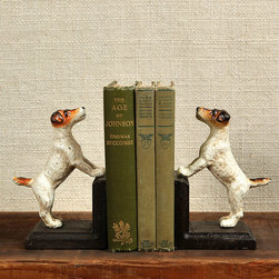 Cast Iron Jack Russel Bookends - Where is it written that bookends need be stately? The charming Jack Russell Bookends bestow a bit of whimsical panache to your personal library, study, or writer's desk. Rendered in realistic coloration, the two pups appear to be gazing longingly at their master, an unexpected visitor, or perhaps a dallying bird in a summer bough.