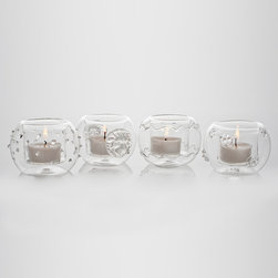 LaBoheme Clear Round Votives - Set of 4 - A quartet of iconic designs give a slightly different personality to each of the LaBoheme Clear Round Votives, a unique set of globe-shaped candleholders which hold a votive or tealight in a cleverly-formed central depression.  Display the four designs � dots, zig-zags, lion's head cartouches, and an abstract berry pattern � together for an eclectic look, or scatter them for perfect planning of even your smallest d�cor elements.
