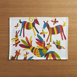 Otomi Placemat - The signature style of Mexico's Otomi artisans gives us a vibrant, multi-colored menagerie, dancing across a white cotton placemat.
