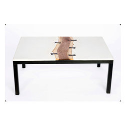 """The 'butterfly' table.  Concrete, walnut, ebony, and steel coffee table - The top of this coffee table is white concrete joined to live edge walnut using ebony wood butterfly joints.  The base is welded 1.5"""" steel with a hand applied blackening patina."""