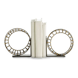 Martina Bookends - Set of 2 - The drama of upright loops and geometric spareness is the focus of these twin circular sculptures, the Martina Bookends.  Made from grey natural iron soldered with bright golden brass, these ring-shaped practical art objects show their handcrafted nature in a balanced, meditative form that complements linear furnishings and minimalist spaces.