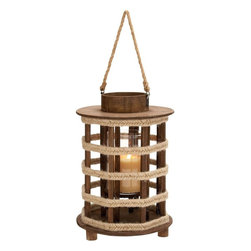 Benzara - Design Wood Lantern with Convenient Rope Handle - Revive that old world charm with this magnificently designed lantern that sports attractive features. The lantern is made of high quality wood components that is pieced together to produce a stunning piece of art. The circular base gives rise to a cage like pattern that is worked up with wooden sticks placed all around. Thin strips run around to fasten these wood pieces firmly and give a definite lantern figure. The lantern is covered with a circular disc capped by a smaller, heavier one on top. There is a convenient provision inside in the center to place the candle or lamp making the lantern glow in style. While the lantern can be used effectively in the dark, it can also be displayed as such as an art piece to enhance the room decor. The top cap has two small rings in which a rope is tied to enable carrying of the lantern easily and comfortably..