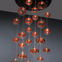 Saturn Chandelier - Our SATURN ROUND blown glass pendant light, shown in Clear with Amber Rings. Available in multiple colors and sizes. Can be made with single or multiple pendants on a single canopy.