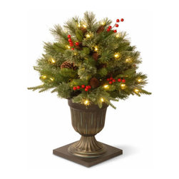 26 In. Feel Real Colonial Porch Christmas Bush w/ 50 Clear Lights - Measures 26 inches tall with 22 inch diameter. Indoor or covered outdoor use. Features FEEL-REAL branch tip technology for remarkable realism! Pre-lit with 50 UL listed, pre-strung Clear lights. Trimmed with red berries and pine cones. Decorative urn base. Tip count: 167. Light string features BULB-LOCK to keep bulbs from falling out. If one bulb burns out the others remain lit. Includes spare bulbs and fuses. Fire-resistant and non-allergenic. Packed in reusable storage carton.