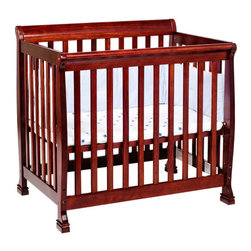 "DaVinci - Kalani Mini 4-in-1 Convertible Crib - Kalani is cool and confident. It's DaVinci at its best. With first class engineering, the Kalani Mini Crib gives baby years of sweet serenity in a smaller package. In one simple conversion, this mini crib becomes a twin bed for when baby's all grown up. It's Cool. It's Kalani. Features: -Kalani collection. -Non-toxic finish. -JPMA Certifed. -Made of solid New Zealand Pine wood from sustainable forests. -Mattress support that can be adjusted to 4 levels to adjust to your grwoing baby. -Included 1"" waterproof pad. -Can be converted to twin size bed win optional conversion rail. -1-Year limited warranty. -This is a NON-Drop Side crib. Dimensions: -Weight limit: 35 lbs. -40"" H x 27.88"" W x 38"" D."