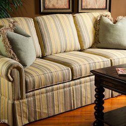 Sofa - This classic three-seat, three-back striped sofa in cheery yellow and teal is the perfect piece to balance out teal and/or yellow accents in a room. A dressmaker skirt and panel arm give it a tailored look.