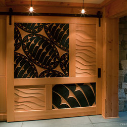 Carved Doors - This carved sliding door was a collaboration between Real Carriage Door Co. and David Franklin, a renowned carver in the Pacific Northwest.