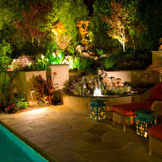 Eclectic Patio by Artisan Home Resorts