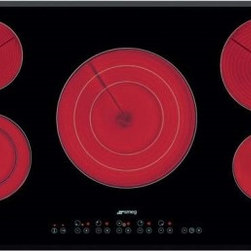 "Smeg - S2951TCU 36"" Smoothtop Electric Cooktop With 5 High-Light Radiant Elements Inclu - The Smeg ceramic cooktop angled-edge glass with 5 high-light radiant elements including 2 variable zones has pristine characteristics that combines style and high technology The 9 power levels for each zone offers a spectrum of heat power that can ac..."
