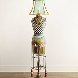 """MacKenzie-Childs - Dressmaker's Floor Lamp - MacKenzie-ChildsDressmaker's Floor LampDetailsHandcrafted floor lamp features a vintage-style dress form meticulously outfitted from head to toe with handcrafted details: a translucent wire-form lampshade; terra cotta and mirror shards; gold-tone passementerie necklace with beads chains and charms; hand-painted landscape mural and Courtly Check designs; floral decals; brass nailhead trim and dotted glass-bead fringe; and stainless steel skirt form with Argentina tassels. Brass base.Songbird on a Cheltenham ball finial.Wired to accommodate one 100-watt bulb; 40-watt Edison antique-style bulb included.18.5""""Dia. x 74.5""""T.Imported.Boxed weight approximately 50 lbs. Please note that this item may require additional delivery and processing charges.Designer About MacKenzie-Childs:Established in 1983 MacKenzie-Childs combines vibrant colors and patterns to create a whimsical collection of tableware furniture and decorative accessories that epitomize """"tradition with a twist."""" The company's designers draw inspiration from the pastoral setting of their studios located on a 65-acre former dairy farm in Aurora New York."""