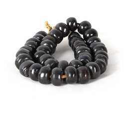 Black Bone Beads Medium - Though they are carved from bone, these pale chalk-white rondelle beads look as though they might be hand-rolled in unfinished pottery with their matte finish and slight irregularities of shape and size. �This knotted strand can be put to dozens of uses in the home, bringing an African-import flavor in blending neutral colors to your decor. �A perfect transitional accessory, they're superb for easing the formality of a stiff vignette with a more natural spontaneity.