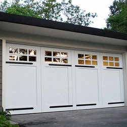 "Dynamic Garage Door - Los Gatos, CA Custom Garage Doors | Carriage House Style Designer Garage Doors! - Custom Garage Doors come in all sorts of styles and sizes but the traditional carriage house style is by far one of the most popular garage door designs that are highly acclaimed by today's design standards.  This carriage house garage door was genuinely designed with an ""arrowhead"" tongue and groove slat design that draws a bold statement on the traditional style.  The custom-forged iron hinges added a flair of traditional swing open functionality while your eyes will be dumbfounded when the garage doors are automatically operated at the press of the button and the sectional garage door rolls up into the overhead.  Dynamic Garage Door has the design expertise to get away with bold design variations that stay true to the architectural charm of the past with today's technological commodity while spicing the overall design with a swift blend of the extraordinary!  We specialize in recreating carriage house garage door styles that complement all sorts of architectural home styles such as Tudor, Craftsman, Carriage House, Ranch House and many other traditional architectural applications!"