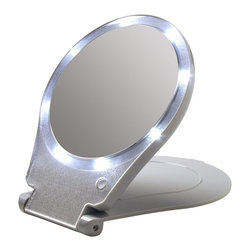 Floxite - LED Lighted Magnifying Mirror - Includes 3 AAA batteries. 10x magnifying mirror. Distortion free DFP glass. Bright LED lighting bulbs never need to replace. Cover turns into stand for hands free viewing. Made from plastic and glass. Light gray finish. No assembly required. Viewing area: 6 in. Dia.. Overall: 10 in. W x 7.5 in. H (2lbs.)Lighted mirror great for home or travel.