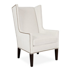 Juillet Host Chair in Patton White - The classic wing chair has been a design staple for centuries, and for good reason: its tailored, finished shape and welcoming depth are both inviting and attractive.  This example is sleek and pleasingly transitional with geometric outlines to its upholstered wings and arms, giving the timeless shape a natty and decisive effect.  Tapered legs support the chair to keep its profile narrow and lofty, while the box seat cushion has self-piping for a professional edge.