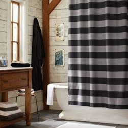 Rugby Stripe Shower Curtain - Stripes are everywhere in design these days. This gray and black shower curtain is just right for a masculine bathroom or for someone who is a bit on the minimalist side. I love that the horizontal stripes are bold. This shower curtain certainly makes a statement.