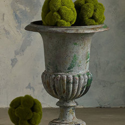 Medici Vintage Urn - Over a century old, this cast iron Medici urn has the weathered verdigris patina that comes of decades spent outdoors facing the elements. Beautiful in a garden, we love bringing this sculptural piece indoors to add another textural accent to your decor.