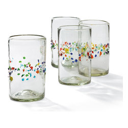 Frontgate - Set of Four Tutti Frutti Highball Glasses - Trapped bubbles and slight variations in form add to the charm. Dishwasher safe, yet best to have a cooling period after drying cycle to prevent damage. Not suitable for serving hot beverages. Specks of color add a touch of fun. Dishwasher safe. Enjoy a cool cocktail as it was meant to be imbibed—from beautiful, handblown glassware. Each piece is uniquely crafted by skilled artisans using recycled glass and is encircled with a confetti-like spray of colored beach glass. The time-honored techniques of mouth blowing and hand shaping imbue each glass with substance, warmth, individuality of shape, and exquisite elegance.  .  .  .  .  . Handcrafted in Mexico .