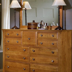 Vaughan Bassett - Triple Dresser & Landscape Mirror Set in Oak - Includes triple dresser and landscape mirror. Triple dresser:. 9 Drawers. 58 in. W x 18 in. D x 44 in. H. Landscape mirror: 42.5 in. L x 2 in. W x 38 in. H. Oak finish. Assembly required
