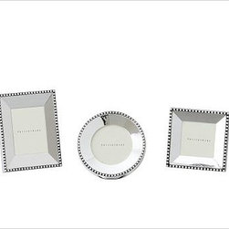 Beaded Silver-Plated Picture Frame, Set of 3 mini, one of each style - Gleaming beads edge the polished planes of our silver-plated frames. They make an excellent showcase for black and white photos. Backed with black velvet. Sealed with lacquer to protect the finish. Designed to display vertically or horizontally on a tabletop. Larger frames are sold individually. The mini frames are available as a set of 3 that includes one of each: square, rectangle and round. Monogramming is available at an additional charge. Monogram will be centered above the photo opening. Frame sits vertically when personalized. Watch a video about creating a {{link path='/stylehouse/videos/videos/dt_v4_rel.html?cm_sp=Video_PIP-_-DESIGN_TIPS-_-NEW_FAMILY_WALL' class='popup' width='950' height='300'}}family photo gallery{{/link}}.