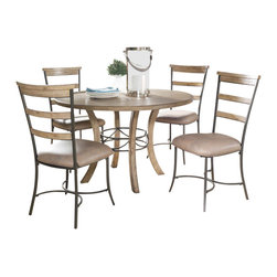 """Hillsdale Furniture - Hillsdale Charleston 5-Piece Wood Base Dining Set with Ladder Back Chairs - Hillsdale's Charleston collection beautifully combines a rustic desert tan wood finish with a dark grey metal and offers a multitude of choices to create the perfect dining group for your home. Starting with the chairs, you have the choice of three lovely designs: The X-Back chair combines a rustic desert tan top accent with a transitional metal X in the center of the back and a brown faux leather seat. The parson's chair is traditional in design and combines the rustic desert tan finish with the brown faux leather seat. The ladder back chair features 3 rungs in the desert tan finish, enhanced by the dark grey metal and brown faux leather seat. Now that you have decided on your chair, let's look at the table options: The stunning rectangle table features a wood top that is generously scaled to easily accommodate 6. The simple round table features a 48"""" diameter wood top with flared metal legs. The round wood table is 48"""" in diameter and features a wonderful metal accent on the base."""