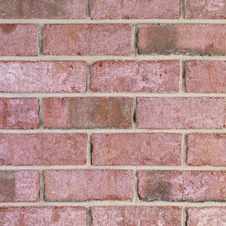 Triangle Brick's Augusta Rose - With a soft rose color evoking the pearly pink on the inside of a seashell, our special production Augusta Rose brick creates a look reminiscent of a quaint English seaside cottage. This gorgeous, textured brick features dark flashed highlights throughout in subtle browns and grays. The Augusta Rose is part of our Select tier, offering a superior level of quality our customers have come to expect from Triangle Brick Company.