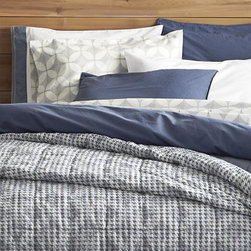 Tiago Stonewash Blue Twin Duvet Cover - Soft, casual stonewashed cotton linens embrace the bed in a gorgeous shade of blue, a perfect solid for mixing and matching with our print collections. Duvet is detailed with double-needle stitching and has a hidden-button closure and interior fabric ties to stabilize duvet insert. Duvet inserts also available.