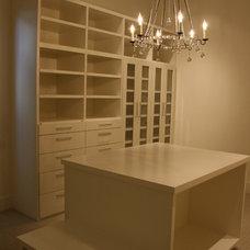 Contemporary Closet by UrbanCraft Custom Builders, LP