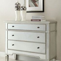Silver Accent Chest - This accent chest is a fine and affordable way to provide an extra storage and bring some elegant notes into your bedroom decor. The modern classic design of this chest is easy to combine with almost any decor style. The storage space is provided by 3 drawers. Each of the drawers features a reflective front and round knobs.