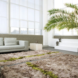 Limited Edtion - WILD – TOP OF THE LINE DESIGN WILD is at the top of the LE range and owes its name to a heady pile of long and lush yarns. In a further design touch, the carpet is traversed by a broad strip of contrasting color, which can be selected by the client. The WILD line comes in 37 attractive colors culled from the new LE Colorbox. Each carpet is made-to-measure and every imaginable form is possible. While the standard pile-height is 10 cm, WILD is also available in a range of shorter pile-heights varying from 3 to 10 cm.