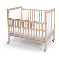 Whitney Bros Co - Whitney Brothers Clear View Folding Rail Crib - WB9507 - Shop for Cribs from Hayneedle.com! Featuring the strongest safest folding crib rail in the institutional market the Whitney Brothers Clear View Folding Rail Crib meets or exceeds all safety standards. This compact crib is a nice alternative to the drop side cribs which are no longer made due to safety concerns. The Folding Rail Crib offers the safety of a stationary crib with the convenience of a drop side crib in that the top portion of one rail folds down making it easier to reach baby. Constructed of hardwood maple this crib also features a clear non-distorting acrylic panel on each end so caregivers can see baby from virtually any angle. The 3-inch thick mattress is included as are the four locking casters. This crib arrives ready to assemble. It's made in the USA and is GreenGuard and CPSIA Certified. This crib has a Limited Lifetime warranty. About Whitney BrothersSince 1904 Whitney Brothers been using classic cabinetmaking techniques to produce safe and sturdy educational toys. Now they're also a leader in developing versatile innovative furniture and storage systems for schools day-care centers and private homes. When they design and manufacture their educational toys and furniture Whitney Brothers uses the finest hardwoods and veneers and traditional joinery methods for extra strength. Edges and corners are always rounded smoothly and finished by hand. All of their glues paints and finishes are nontoxic and easy to clean.