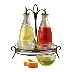 Home Essentials - Villa Cruet Set with Dipping Bowls on Iron Stand - Keep Kitchen Staples handy, and organized in the glass cruet set part of the villa collection by Home Essentials. Have the oil and, vinegar within hands reach, and covered with an Easy pour spout.  * Set includes 2 glass cruets , and wire rack, 4 dipping bowls