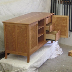 entertainment center in cherry - a view of the drawers in action