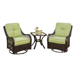 Hanover - Orleans 3-Piece Seating Set (2 Swivel Gliders, 1 End Table) - The vibrantly designed Hanover ORLEANS3PCSW 3-piece patio set transforms any backyard into an intimate relaxation area with its deep comfort feel and superior quality. This set is comprised of two deep-cushioned rocking chairs and an elegant glass end table, all featuring a rich chocolate-colored wicker frame composed out of hand woven straps, providing both crisp color pigments and ultimate UV protection. This sophisticated wicker is well coated to be all weather-resistant and rust free during the toughest weather conditions. Even the Avocado-colored cushions are built to last with a high grade of 100% polyester wrapped around polyurethane foam, ensuring deep comfort while maintaining its original full shape. The fabric of the cushions are also specifically designed, woven, and treated for quick drying while resisting stains and UV harm. This 3-piece set will provide you with the most comfortable rocking relaxation under the sun. Minor assembly is required.