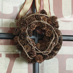 Ballard Designs - Pinecone & Vine Wreath - Use season after season. Sturdy metal ring hanger. Each pinecone in this beautifully hand crafted wreath is specially selected for its uniform size and perfect shape. Dozens of natural pinecones are woven over a wire frame and laced with faux vine for added texture. Tuck in your own berry sprigs or holly for pops of festive color.Pinecone & Wreath features: . .