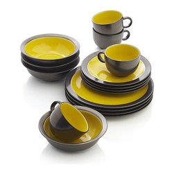 Sol 16-Piece Dinnerware Set - Sunny, glossy yellow interiors radiate warmth in casual, rounded shapes and bold rims, glazed bronzy brown. Patterning of reactive glazes will vary from piece to piece.