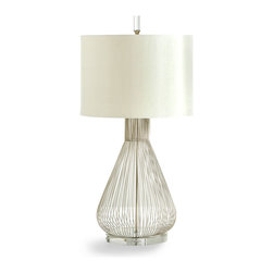 Whisked Fall Table Lamp - A handsome, approachable piece that fuses found-object fun with a more formal shape, the Whisked Fall Table Lamp is made from silver wires gathered to resemble the kitchen implement that gives this updated task-lighting piece its name.  Hollow and airy, the metallic lamp base supports a white drum shade to maintain its clean color scheme.