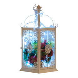The Firefly Garden - Snowflake - This arrangement will remind you of the first winter snow, sparkling with red and green accents in an antique white lantern. Snowflake is portable, so that you can explore a variety of decorative settings for the holiday season.