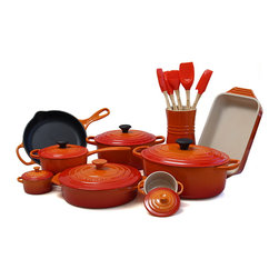 Le Creuset - Le Creuset 20 Piece Cast Iron and Stoneware Cookware Set, Flame - Combining the most colorful cookware with durable cast iron and stoneware, this Le Creuset 20 piece cookware set will add beauty and functionality to your kitchen. Le Creuset's iconic enameled cast iron 5 quart oval French oven, as well as a 3.5 quart French oven, a covered 1.75 quart saucepan, and a 9 inch skillet.