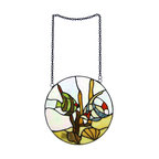 Zeckos - Stained Glass Window Panel - Tropical Fish - This beautiful leaded stained glass window panel adds a great whimsical accent to any room. Simply hang the panel in front of a window, using the 2 hanger rings, allowing the light to pass through the over 50 pieces of amber, green and red stained glass with round glass cabochons. This hanging features two tropical fish in an aquarium setting. Measuring 10 inches in diameter, the panel gives a look of playfulness to living rooms, kitchens and bedrooms. The panel is brand new, never used or displayed. It makes a great gift for friends and family. We have a very limited supply of these, so don't delay. Get yours now