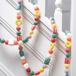 Dancing Candy Garland - These peppermints, peach rings and gumballs look so real, I'd almost take a bite from them. Use this string to decorate your tree or to add some glee to a stairwell.