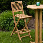 Folding Teak Bar Chair - Great for entertaining at a backyard dinner party, this tall bar chair is perfect for any occasion. Pair two or four chairs around the matching tall bar table (sold separately) for a coordinated look.