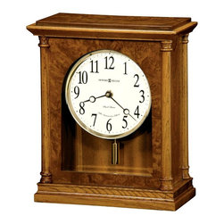"Howard Miller - Howard Miller - Carly Mantel Clock - The Bogie of clocks, this timepiece rests stylishly and subtly atop of any mantel while managing the hour upto the very last minute. Cylindrical pendulum and melds of wood manages to make the hour a simply remarkable classic piece. * This 79th Anniversary Edition mantel clock combines classic style with contemporary details. Wood columns frame all four corners of the case; elegant burl adds a touch of luxury to the front and top panels. . The front beveled glass offers a view of the off-white dial. Polished brass bezel. Special Anniversary Edition inscription (through 2005). Arabic numerals, and stylish black hands. . A unique polished brass, cylindrical pendulum complements the bezel. . Finished in Golden Oak on select hardwoods and veneers. . Quartz, dual chime movement plays Westminster or Ave Maria chimes, and features volume control and automatic nighttime chime shut-off option. . H. 11-1/2"" (29 cm). W. 9-3/4"" (25 cm). D. 4-3/4"" (12 cm)"