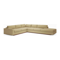 True Modern - Jackson corner sectional w/ bumper - Toast - The Jackson 114 x 134 Corner Sectional with Bumper is a great addition to a modernist living room, family room or even an office setting. The bumper allows your sofa to bleed into the room without having the harsh and abrupt edge of the arm. There is no need for a side table on the bumper side of this sofa. The oversized seat, arms and pillows make it the ultimate lounger, but the clean design still keeps it modern and hip. The seat cushions are wrapped in down and the back pillows are stuffed with luxurious blend of feather and down as well. Our exclusive baffled system helps keep the feathers in place so you won't need to constantly fluff the pillows. The wooden base is hidden so the sofa really appears to be floating on air. The low slanted back let's you lay back, stretch out and relax. Add an ottoman and really kick back! Its polyester woven fabric is durable and soft with a great multi tone texture.