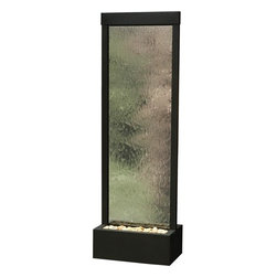 7.5' Black Onyx Gardenfall With Clear Glass Floor Fountain - If you have a contemporary, simplistic, Asian or safari-themed space, this 7.5' Black Onyx Gardenfall with Clear Glass Floor Fountain will complement it exquisitely. The water can be enjoyed from any angle as it cascades over the glass because the panel is center-mounted. Therefore, no matter where you place it, the same beautiful appearance will be appreciated. The black onyx frame is bold and powerful while polished river stones bring softness to the piece. Halogen lighting ensures that the fountain is gaze- worthy even at night.