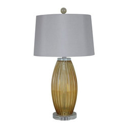 Pre-owned Amber Glass Table Lamp with White Shade - A Pair - This pair of 3-Way Amber Glass Table Lamps offers a modern style featuring an opaque amber finish and a white modified fabric drum shade. These lamps are rated for 120-volts and uses a 150-watt incandescent or 23-watt CFL bulb, not included. The light source is soft and the illumination provided is ambient lighting. There is a 3-way rotary on/off switch placed on the body of the socket, has a clear colored cord and shade mounts with a harp. This product is UL and ETL listed and approved. Each lamp measures 16-inches (D) 16-inches (W) by 30-inches (H), and 7.7-pounds. These lamps are a perfect addition to your living room, family room, dining room, foyer, office or ideal for an end table next to a chair or couch. These lamps come with a 1-year limited warranty against defects in materials and workmanship.     • Features an white fabric drum shade with an opaque amber finish  • Measures 16-inches (D) 16-inches (W) by 30-inches (H), 7.7-pound  • 150-watt incandescent or 23-watt CFL bulb, not included   • This is a set of two lamps  • Comes with a 1-year limited warranty