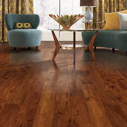 Mohawk Rashciato Hardwood - This is a great choice for a traditional and rustic feel with a classic tone. We love this room that features the Raschiato Warm Cherry color.